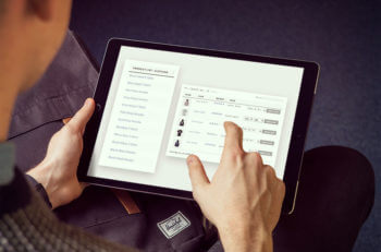 Person using WooCommerce Product Table on iPad