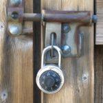 A lock on a wooden door.