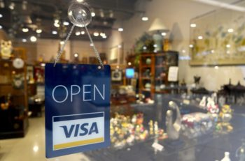 """An """"Open"""" sign on a storefront."""