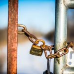 A padlock on a fence.