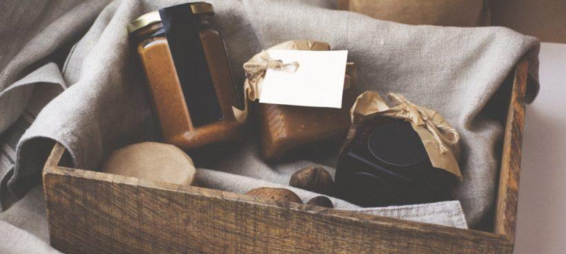 Crate with various food jars.